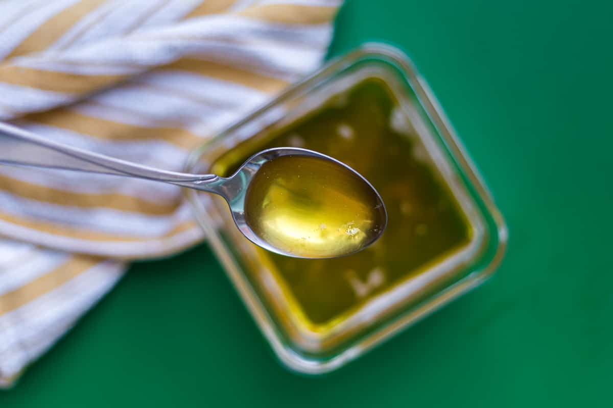 A spoonful of freshly made ghee that hasn't solidified yet.
